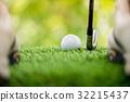 strike the golf ball 32215437