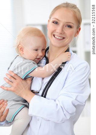 Pediatrician is taking care of patient in hospital 32215568