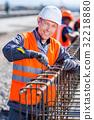 worker fixing steel rebar at building site 32218880