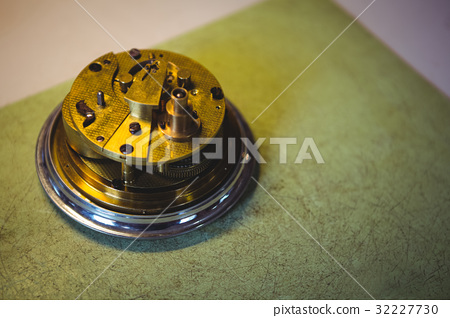 Parts of a watch in workshop 32227730