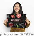Woman holding billboard network graphic overlay 32230754