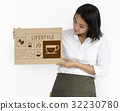 Coffee shop owner holding advertising banner 32230780