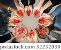 Group of hands holding red ribbon stop drugs and HIV/AIDS awareness 32232030