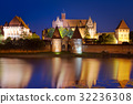 The castle in Malbork at night, Poland 32236308