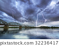 Summer thunderstorm over the Vistula river 32236417