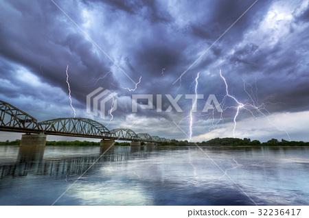 Summer thunderstorm over the Vistula river 32236417