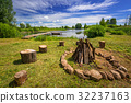 Campfire place at the lake in summer time, Poland 32237163