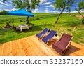 Deckchairs in the summer garden 32237169