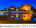 The Castle in Malbork at dusk, Poland 32237219