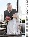 Vertical photo of happy couple while looking at 32240512