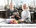 Delighted mature couple having appointment 32240609