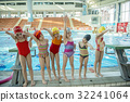 Instructor and group of children doing exercises 32241064