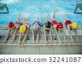 Instructor and group of children doing exercises 32241087