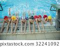 Instructor and group of children doing exercises 32241092