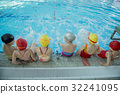 Instructor and group of children doing exercises 32241095