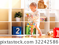 Toddler girl playing in her house 32242586