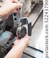 operator machining mold part by CNC machine 32243790