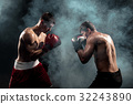 Two professional boxer boxing on black smoky 32243890