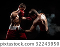 Two professional boxer boxing on black smoky 32243950
