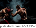 Two professional boxer boxing on black smoky 32243952