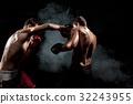 Two professional boxer boxing on black smoky 32243955