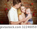 Young happy family with their infant boy 32246050