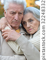 Sad elderly couple in the park 32248332