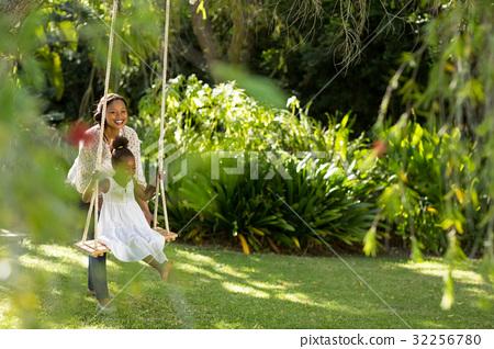 Happy family doing swing 32256780