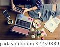 Woman using laptop with flower decorated 32259889