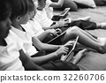 Group of diverse kindergarten students using digital devices 32260706