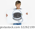 Child with a drawing of astronaut helmet 32262199
