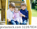 Two little happy kid boys with newborn baby girl 32267834
