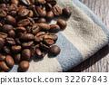 brown coffee beans on wood. 32267843