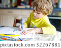 Adorable preschool kid boy painting with colorful 32267881