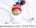 Cute adorable baby child with Christmas winter cap 32267953