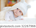 Baby girl wearing white towel or winter overal in 32267966