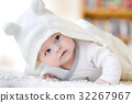 Baby girl wearing white towel or winter overal in 32267967