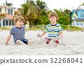 Two little kids boys having fun on tropical beach 32268041