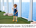 Little kid boy playing mini golf on a cruise liner 32268057