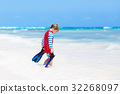 little blond kid boy having fun on tropical beach 32268097