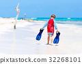 little blond kid boy having fun on tropical beach 32268101