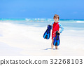 little blond kid boy having fun on tropical beach 32268103