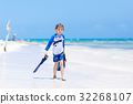 little blond kid boy having fun on tropical beach 32268107