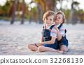 Two little kids boys having fun on tropical beach 32268139