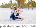 Two little kids boys having fun on tropical beach 32268148