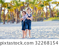 Two little kids boys having fun on tropical beach 32268154