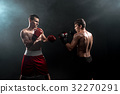 Two professional boxer boxing on black smoky 32270291