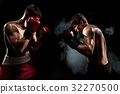 Two professional boxer boxing on black smoky 32270500