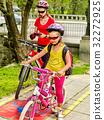 Family bike ride with rucksack cycling on bike 32272925