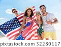 Four cheerful friends having fun on coastline 32280117